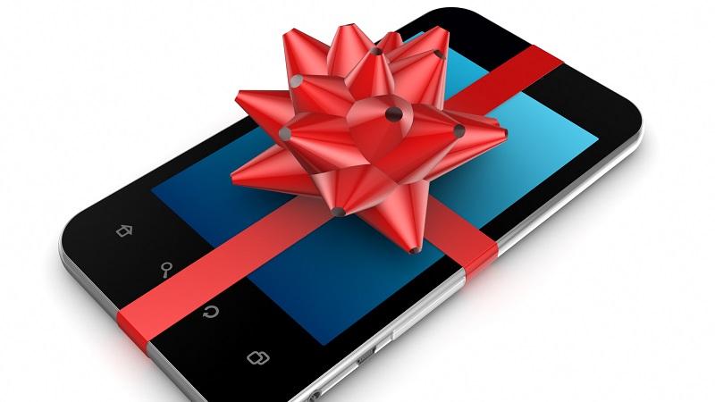 smartphone de presente decorado com uma fita vermelha
