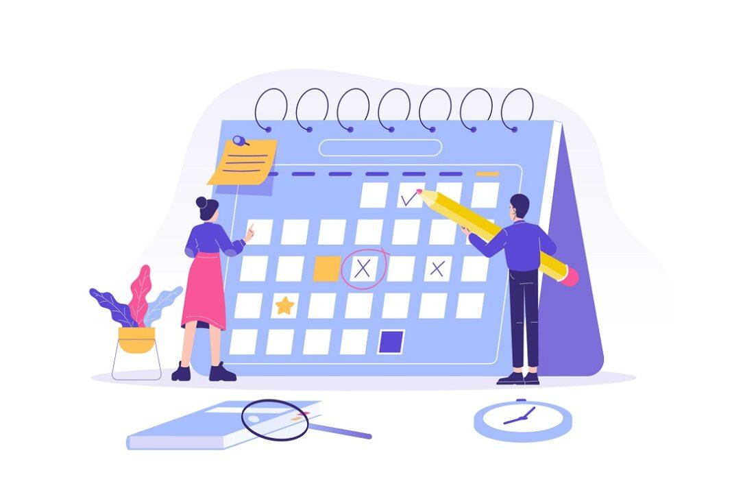 calendário sendo planejado por duas pessoas
