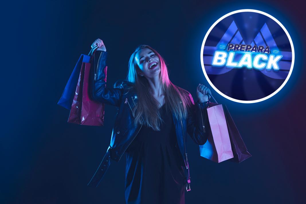mulher feliz com sacolas nas mãos em ação da Black Friday